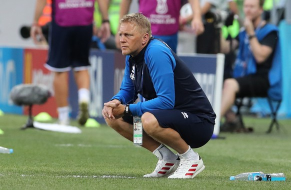epa06831142 Iceland's coach Heimir Hallgrimsson reacts during the FIFA World Cup 2018 group D preliminary round soccer match between Nigeria and Iceland in Volgograd, Russia, 22 June 2018.  (RESTRICTIONS APPLY: Editorial Use Only, not used in association with any commercial entity - Images must not be used in any form of alert service or push service of any kind including via mobile alert services, downloads to mobile devices or MMS messaging - Images must appear as still images and must not emulate match action video footage - No alteration is made to, and no text or image is superimposed over, any published image which: (a) intentionally obscures or removes a sponsor identification image; or (b) adds or overlays the commercial identification of any third party which is not officially associated with the FIFA World Cup)  EPA/ZURAB KURTSIKIDZE   EDITORIAL USE ONLY