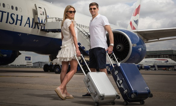 LONDON, ENGLAND - MAY 11:  Steven and Alex Gerrard pose for a picture on a BA777 aircraft to launch British Airways Caribbean Campaign at Heathrow Airport on May 11, 2015 in London, England. Alex is wearing a dress by Isabel Marant and Kurt Geiger espadrilles, Steven wears shorts by Lanvin and a shirt by Orlebar Brown  (Photo by Tom Shaw/Getty Images for British Airways)