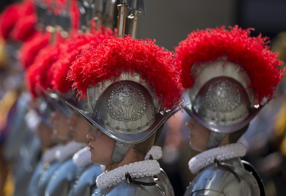 Vatican Swiss guards line up a swearing-in ceremony, at the Vatican, Tuesday, May 6, 2014. The ceremony is held each May 6 to commemorate the day in 1527 when 147 Swiss Guards died protecting Pope Clement VII during the Sack of Rome. (AP Photo/Alessandra Tarantino)