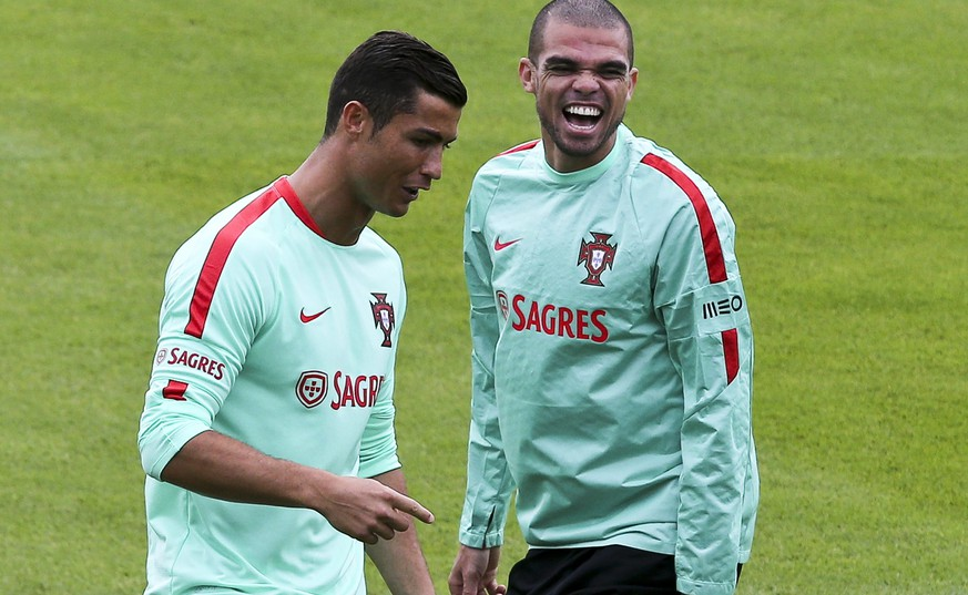 epa05358717 Portugal soccer team players Cristiano Ronaldo (L) and Pepe (R) during their training session in Marcoussis near Paris, France, 12 June 2016. The UEFA EURO 2016 soccer championship takes place from 10 June to 10 July 2016 in France.  EPA/MIGUEL A. LOPES