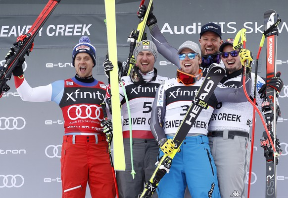 Austria's Max Franz (5) celebrates with Switzerland's Mauro Caviezel, left, Norway's Aleksander Aamodt Kilde (3), Norway's Aksel Lund Svindal, top right, and Italy's Dominik Paris, right, after a Men's World Cup super-G skiing race Saturday, Dec. 1, 2018, in Beaver Creek, Colo. Franz finished first, Caviezel finished second, and Kilde, Paris (6) and Lund tied for third. (AP Photo/John Locher)