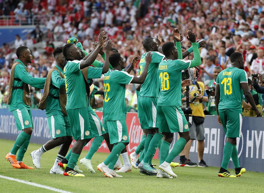 epa06821876 Senegal's player celebrate after winning the FIFA World Cup 2018 group H preliminary round soccer match between Poland and Senegal in Moscow, Russia, 19 June 2018.