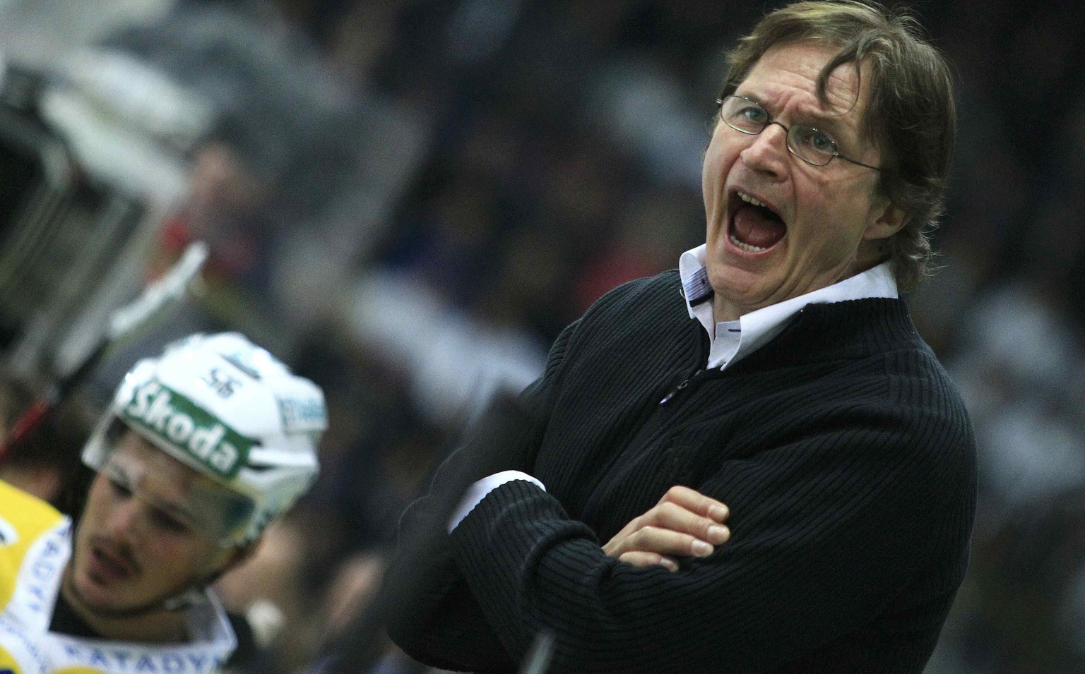 Coach Arno del Curto of HC Davos reacts during their Swiss ice hockey play-off final match against Kloten Flyers in Kloten near Zurich April 12, 2011. REUTERS/Miro Kuzmanovic (SWITZERLAND  - Tags: SPORT ICE HOCKEY)