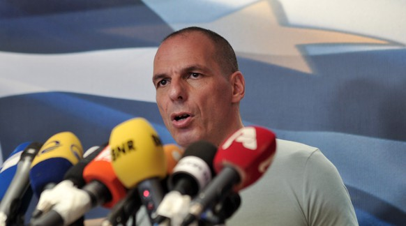 Greece's Finance Minister Yanis Varoufakis makes statements at the Finance Ministry after the results of referendum in Athens, Sunday, July 5, 2015. Greeks overwhelmingly rejected creditors' demands for more austerity in return for rescue loans in a critical referendum Sunday, backing Prime Minister Alexis Tsipras, who insisted the vote would give him a stronger hand to reach a better deal. (AP Photo/Angelos Christofilopoulos)