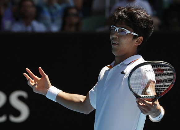 South Korea's Chung Hyeon reacts after winning the second set against United States' Tennys Sandgren during their quarterfinal at the Australian Open tennis championships in Melbourne, Australia, Wednesday, Jan. 24, 2018. (AP Photo/Ng Han Guan)