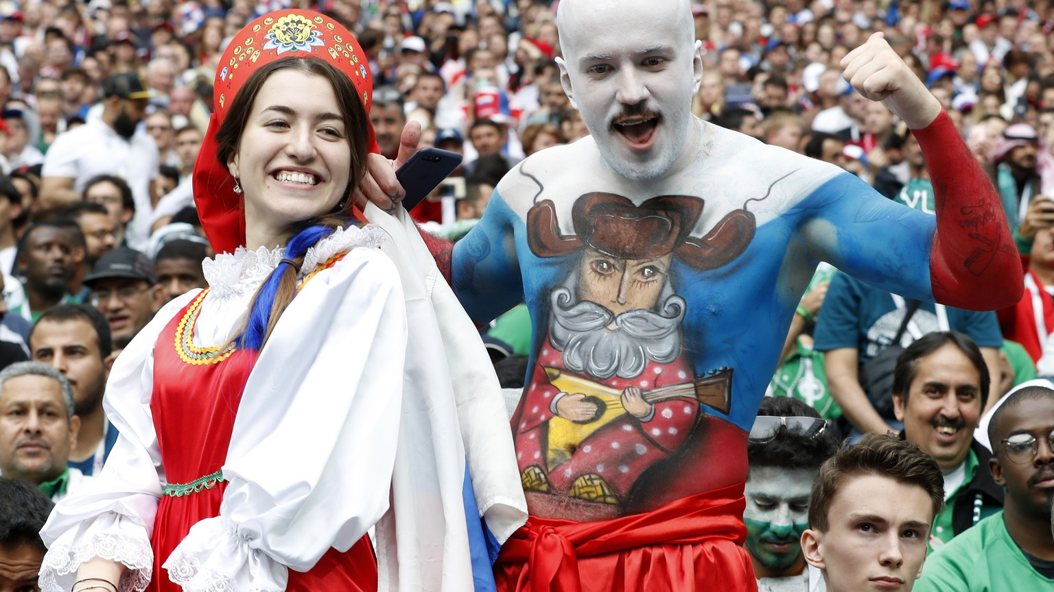 epa06807309 Russian fans pictured before the start of the FIFA World Cup 2018 group A preliminary round soccer match between Russia and Saudi Arabia in Moscow, Russia, 14 June 2018.
