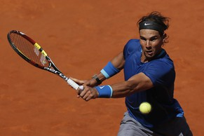2Rafael Nadal from Spain returns the ball during a Madrid Open tennis tournament match against Tomas Berdych from Czech Republic in Madrid, Spain, Friday, May 9, 2014. (AP Photo/Andres Kudacki)