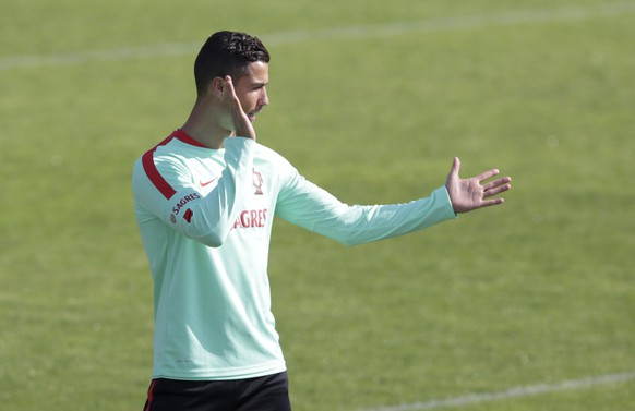 Portugal's Cristiano Ronaldo gesturesduring a training session in Oeiras, outside Lisbon, Monday, Oct. 9, 2017. Portugal will face Switzerland in a World Cup Group B qualifying soccer match in Lisbon Tuesday. (AP Photo/Armando Franca)