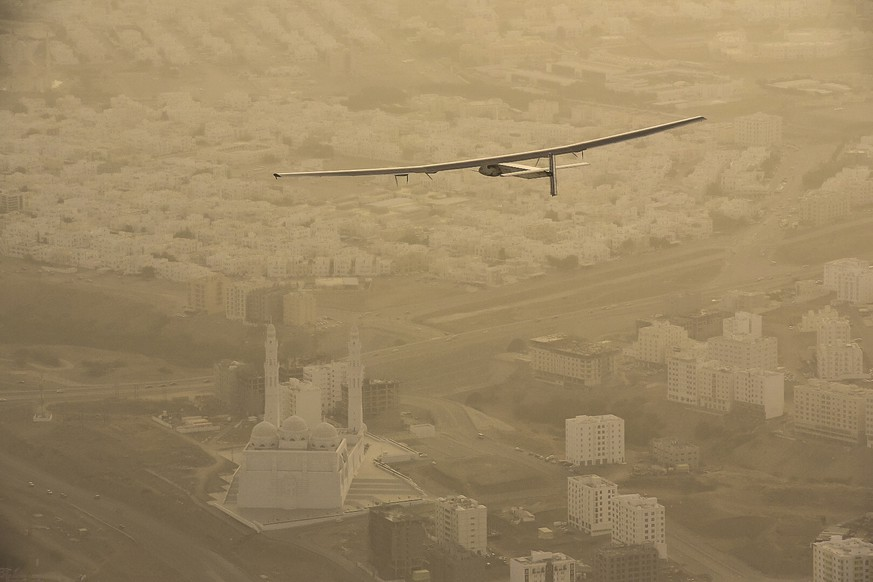MUSCAT, OMAN - MARCH 10:  In this handout image supplied by Jean Revillard, Solar Impulse 2, a solar-powered airplane piloted by Bertrant Piccard, starts the day's journey bound for Ahmedabad, India March 10, 2015  over Muscat, Oman. With this 15:20-hour flight, Piccard set a new world record for solar distance flight with 1486 kilometers. The trip continues on March 16. The 35,000km journey is expected to last five months and is piloted by Andre Borschberg and Bertrand Piccard of Switzerland. The Solar Impulse 2 is equipped with 17,000 solar cells, has a wingspan of 72 metres, and yet weighs just over 2 tonnes. (Photo by Jean Revillard via Getty Images) *** BESTPIX ****
