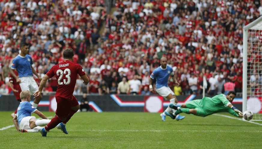 Liverpool's Xherdan Shaqiri shoots at goal but his shot is saved by Manchester City's goalkeeper Claudio Bravo during the Community Shield soccer match between Manchester City and Liverpool at Wembley Stadium in London, Sunday, Aug. 4, 2019. (AP Photo/Frank Augstein)