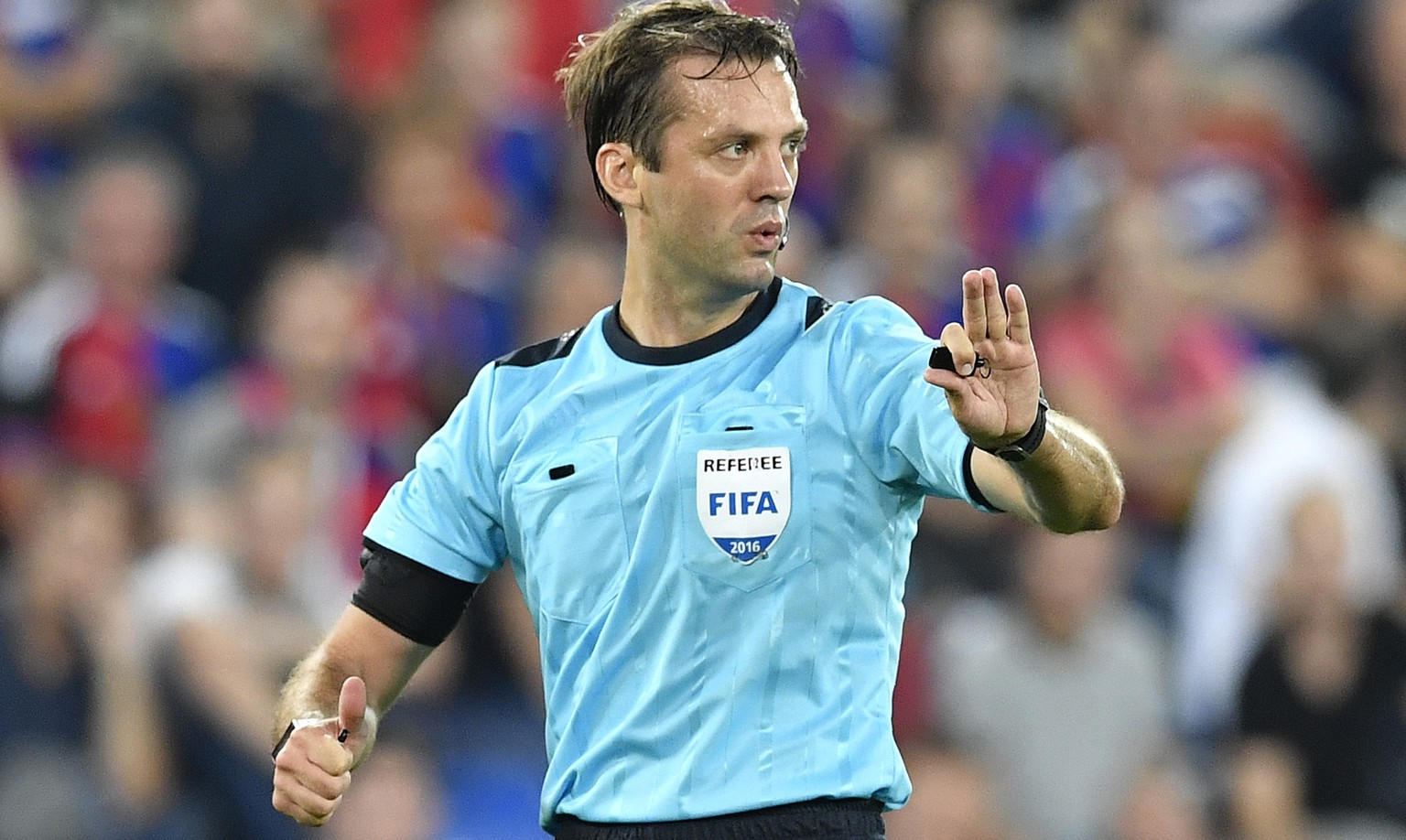 Referee Aleksei Kulbakov of Belarus reacts during an UEFA Champions League Group stage Group A matchday 1 soccer match between Switzerland's FC Basel 1893 and Bulgaria's PFC Ludogorets Razgrad in the St. Jakob-Park stadium in Basel, Switzerland, on Tuesday, September 13, 2016. (KEYSTONE/Peter Schneider)