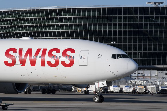 """An aircraft Boeing 777 of Swiss International Air Lines in the front of """"the Circle"""" at the Zurich Aeroport, in Zurich, Switzerland, Monday, April 27, 2020.  (KEYSTONE/Ennio Leanza)"""