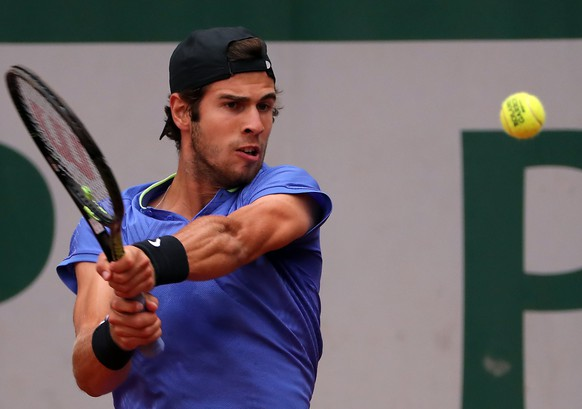 epa06008194 Karen Khachanov of Russia in action against John Isner of the USA during their men's singles 3rd round match during the French Open tennis tournament at Roland Garros in Paris, France, 03 June 2017.  EPA/TATYANA ZENKOVICH