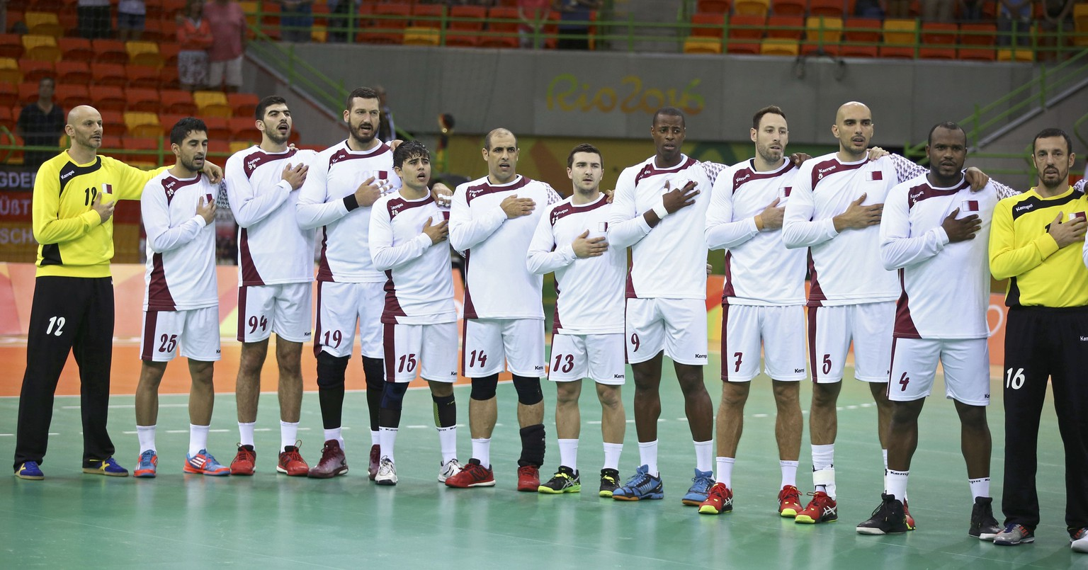 2016 Rio Olympics - Handball - Preliminary - Men's Preliminary Group A Qatar v France - Future Arena - Rio de Janeiro, Brazil - 09/08/2016. Qatar's players sing the national anthem before the match. REUTERS/Marko Djurica FOR EDITORIAL USE ONLY. NOT FOR SALE FOR MARKETING OR ADVERTISING CAMPAIGNS.