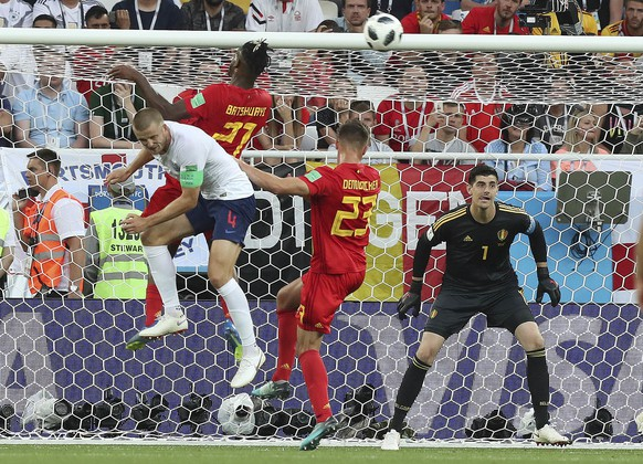 Belgium's Michy Batshuayi, second from left, and Belgium's Leander Dendoncker defend against England's Eric Dier during the group G match between England and Belgium at the 2018 soccer World Cup in the Kaliningrad Stadium in Kaliningrad, Russia, Thursday, June 28, 2018. (AP Photo/Czarek Sokolowski)