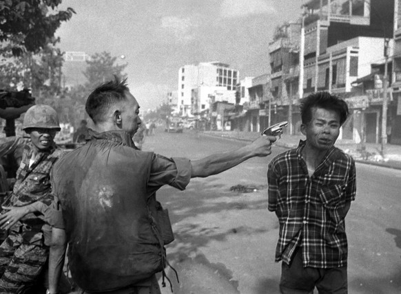 "FILE - In this Feb. 1, 1968 file photo, Gen. Nguyen Ngoc Loan, South Vietnamese chief of the national police, fires his pistol into the head of suspected Viet Cong official Nguyen Van Lem on a Saigon street early in the Tet Offensive. Photographer Eddie Adams reported that after the shooting, Loan approached him and said, ""They killed many of my people, and yours too,"" then walked away. (AP Photo/Eddie Adams, File)"