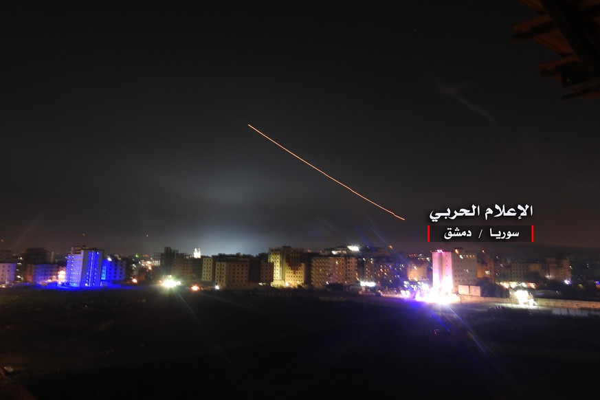 epa06724728 A handout photo made available by government-affiliated Syrian Military Media is said to show Syrian air defense missiles intercepting missile strikes over Damascus, Syria, 09 May 2018 (issued 10 May 2018). According to Syrian official media reports, the air defense was responding to a new wave of Israeli missile strikes.  EPA/SYRIAN MILITARY MEDIA HANDOUT  HANDOUT EDITORIAL USE ONLY/NO SALES