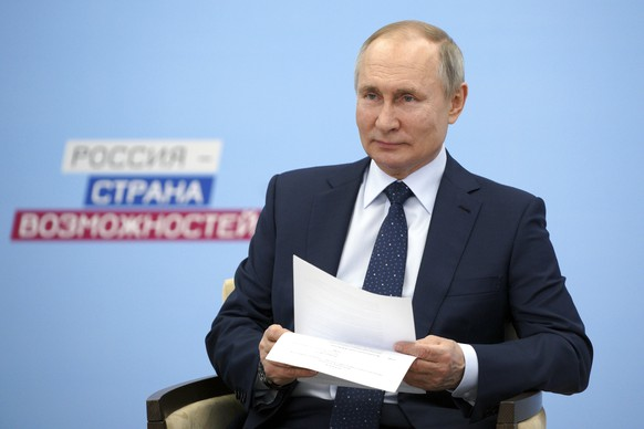 Russian President Vladimir Putin takes part in a video call with participants of a leadership forum via video conference at the Novo-Ogaryovo residence outside Moscow, Russia, Friday, March 26, 2021. (Alexei Druzhinin, Sputnik, Kremlin Pool Photo via AP)