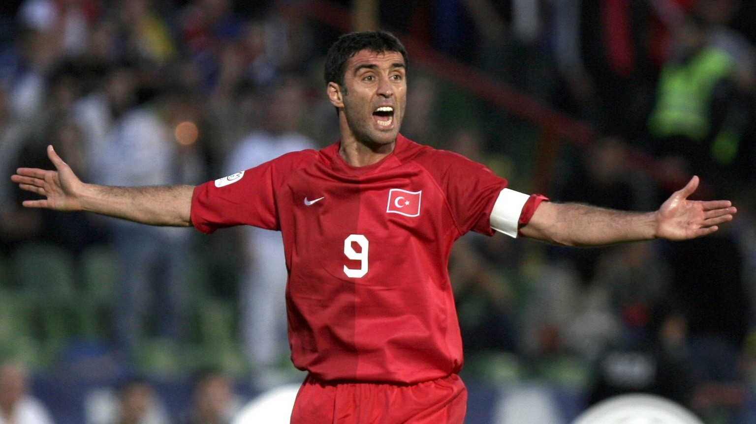 FILE - In this Saturday, June 2, 2007, file photo Turkey's Hakan Sukur reacts during the Group C Euro 2008 qualifying soccer match against Bosnia at the Olympic stadium in Sarajevo. Turkey's state-run news agency reports Friday, Aug. 12, 2016, authorities have issued an arrest warrant for former soccer star and legislator Hakan Sukur over his alleged links to a U.S.-based Muslim cleric, accused by Turkey of masterminding last month's failed coup. (AP Photo/Amel Emric, FILE)
