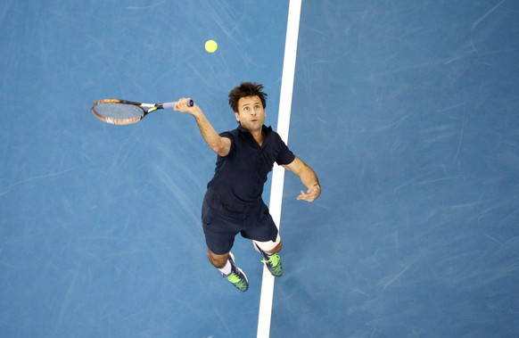 Micromax Indian Aces' Fabrice Santoro of France serves to Manila Mavericks' Mark Philippoussis of Australia during their match at the International Premier Tennis League (IPTL) in Dubai December 12, 2014. REUTERS/Ahmed Jadallah (UNITED ARAB EMIRATES - Tags: SPORT TENNIS)