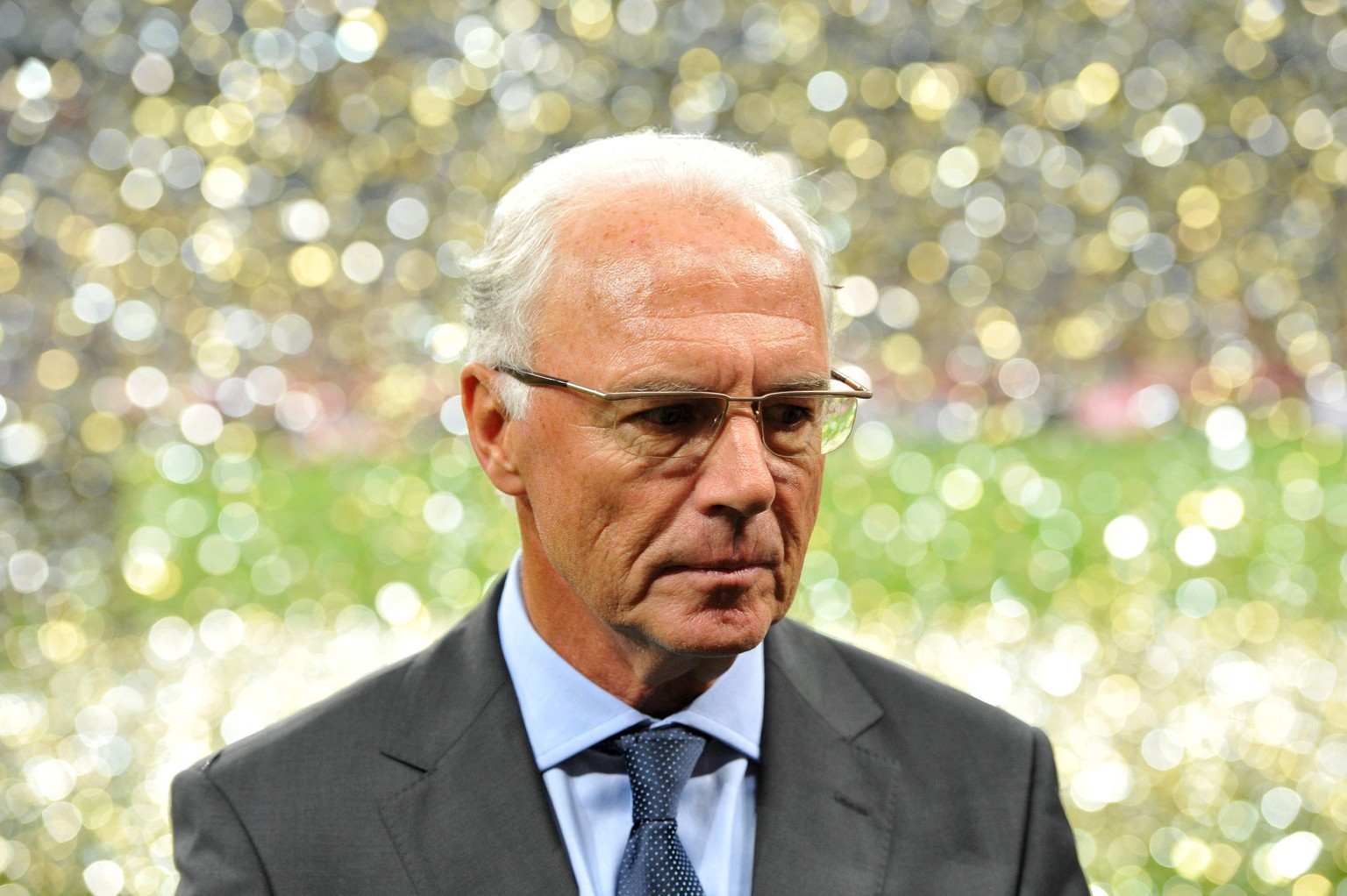 epa05019196 (FILE) A file photograph shows Honoray president of FC Bayern Munich Franz Beckenbauer leaving the pitch after the soccer friendly match between FC Bayern Munich and Real Madrid at the Allianz Arena stadium in Munich, Germany, 13 August 2010. Beckenbauer signed agreement with CONCACAF, signed on their behalf by disgraced former FIFA executive Jack Warner, four days before the 2006 World Cup vote in 2000, interim DFB president Rainer Koch confirmed on 10 November 2015.  EPA/MARC MUELLER