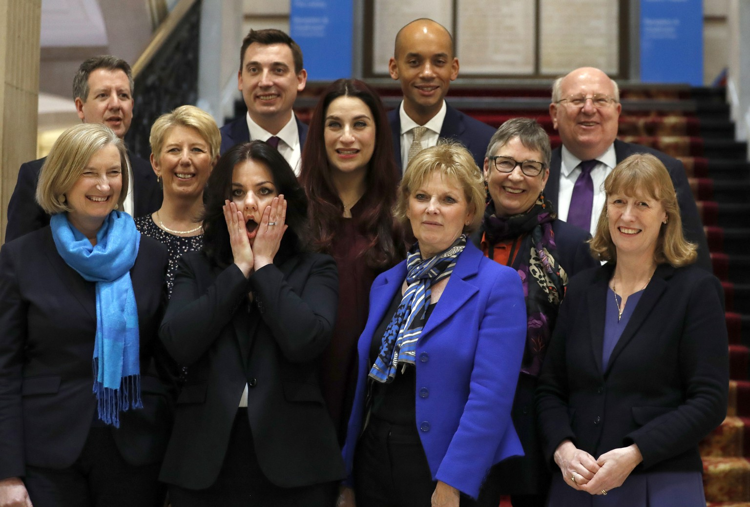 Eleven British lawmakers who have joined new political party 'The Independent Group' pose for a photograph after a press conference in Westminster in London, Wednesday, Feb. 20, 2019. Cracks in Britain's political party system yawned wider Wednesday, as three pro-European lawmakers - Soubry, Allen and Wollaston - quit the governing Conservatives to join a newly formed centrist group of independents who are opposed to the government's plan for Britain's departure from the European Union. (AP Photo/Alastair Grant)