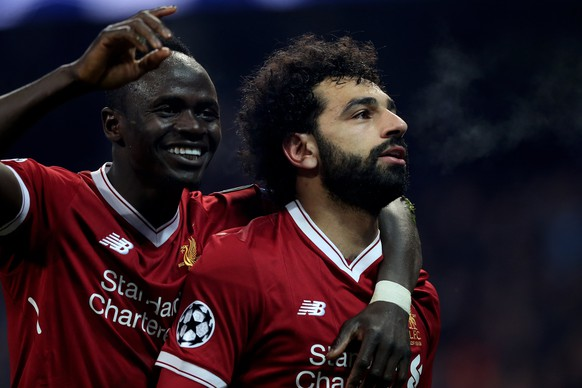 epa06660254 Liverpool's Mohamed Salah (R) celebrates with his teammate Sadio Mane (L) after scoring the 1-1 equalizer during the UEFA Champions League quarter final second leg match between Manchester City and FC Liverpool in Manchester, Britain, 10 April 2018.  EPA/Nigel Roddis