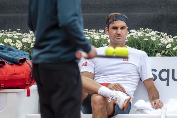 Switzerland's tennis player Roger Federer looks on during a training session prior to the ATP 250 Tennis Geneva Open tournament, in Geneva, Switzerland, Friday, May 14, 2021. (Martial Trezzini/Keystone via AP)