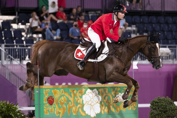 Bryan Balsiger of Switzerland riding Twentytwo des Biches competes in the equestrian team jumping final at the 2020 Tokyo Summer Olympics in Tokyo, Japan, on Saturday, August 07, 2021. (KEYSTONE/Peter Klaunzer)
