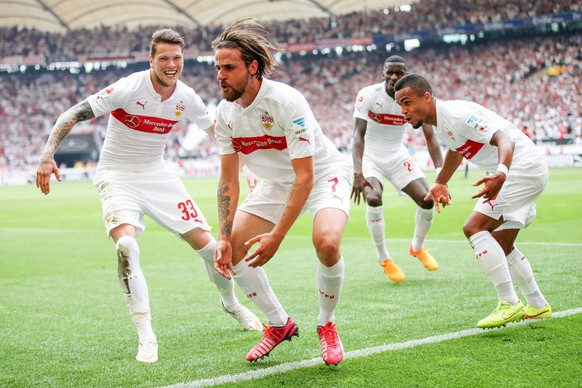 STUTTGART, GERMANY - MAY 16:  Martin Harnik of Stuttgart celebrates his team's second goal with his team mates Daniel Ginczek (L) and Daniel Didavi (R) during the Bundesliga match between VfB Stuttgart and Hamburger SV at Mercedes-Benz Arena on May 16, 2015 in Stuttgart, Germany.  (Photo by Simon Hofmann/Bongarts/Getty Images)