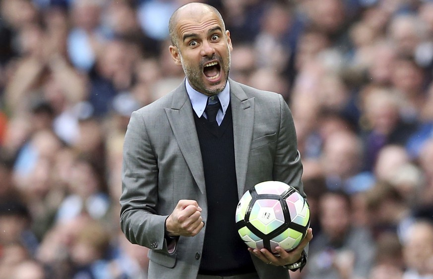 Manchester City manager Pep Guardiola gestures on the touchline, during the English Premier League soccer match between Manchester City and Leicester, at the Etihad Stadium, in Manchester, England, Saturday May 13, 2017. (Martin Rickett/PA via AP)