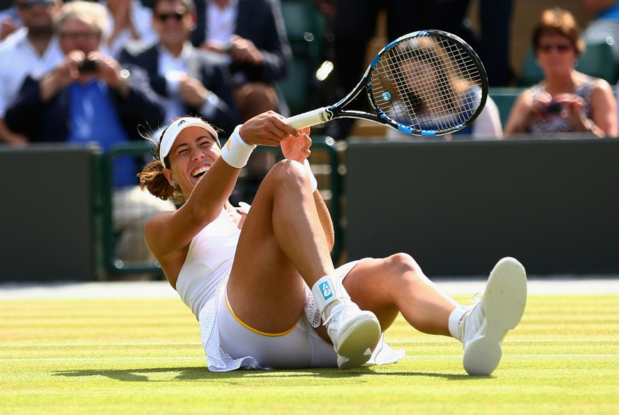LONDON, ENGLAND - JULY 07:  Garbine Muguruza of Spain celebrates match point in her Ladies Singles Quarter Final match against Timea Bacsinszky of Switzerland during day eight of the Wimbledon Lawn Tennis Championships at the All England Lawn Tennis and Croquet Club on July 7, 2015 in London, England.  (Photo by Clive Brunskill/Getty Images)
