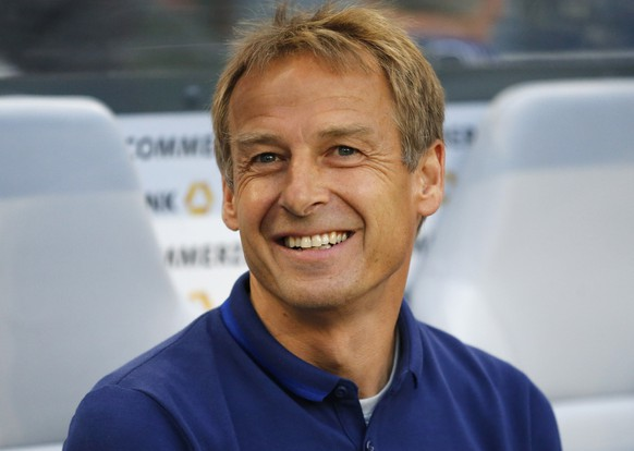 FILE - In this June 10, 20165 file picture United States' head coach Juergen Klinsmann smiles prior to the friendly soccer  match between Germany and the United States in Cologne,  Germany. Juergen Klinsmann, a World Cup winner with Germany, has been named honorary captain of the German national team the Football Federation announced Thursday Nov. 3, 2016.   (AP Photo/Frank Augstein,file)