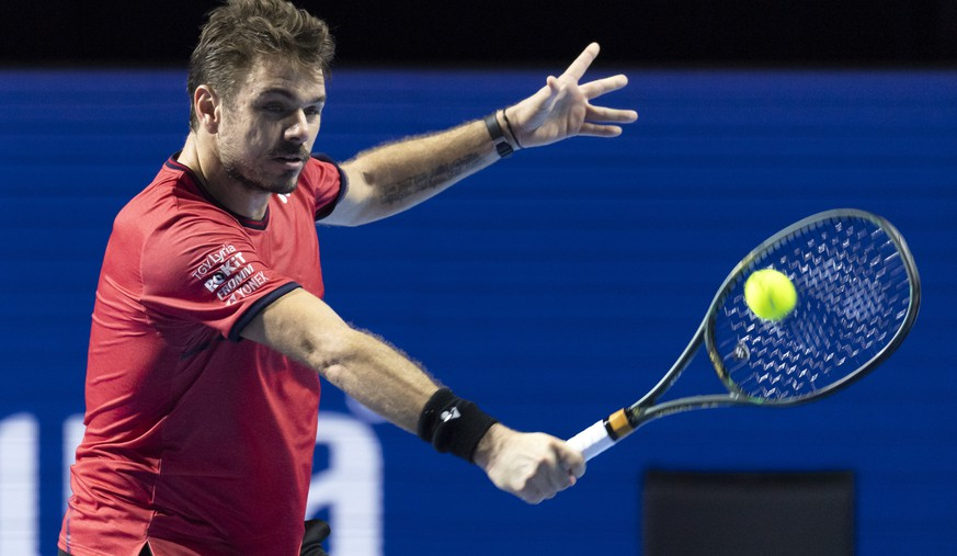 Switzerland's Stan Wawrinka returns a ball to Uruguay's Pablo Cuevas during their first round match at the Swiss Indoors tennis tournament at the St. Jakobshalle in Basel, Switzerland, on Wednesday, Oct. 23, 2019. (Georgios Kefalas/Keystone via AP)