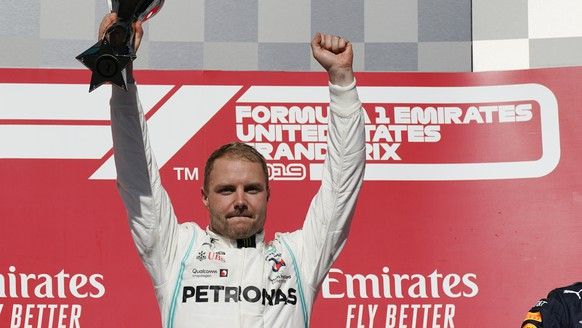 Mercedes driver Valtteri Bottas, of Finland, holds the trophy after winning the Formula One U.S. Grand Prix auto race at the Circuit of the Americas, Sunday, Nov. 3, 2019, in Austin, Texas. (AP Photo/Chuck Burton)