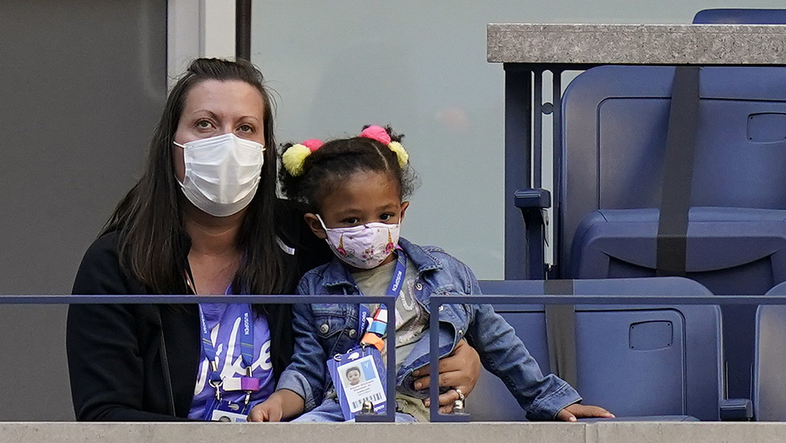 Three-year-old Alexis Olympia Ohanian Jr., right, daughter of Serena Williams, of the United States, watches her mother play against Sloane Stephens, of the United States, during the third round of the US Open tennis championships, Saturday, Sept. 5, 2020, in New York. (AP Photo/Seth Wenig)
