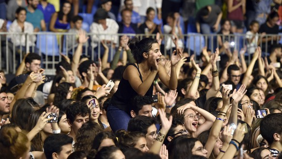 epa06848995 Fans of the British group Clean Bandit cheer during their concert at the Summer Misk Festival 2018 in Beit Misk east Beirut, Lebanon, 28 June 2018. The festival runs for two days on 22 and 28 June 2018.  EPA/WAEL HAMZEH