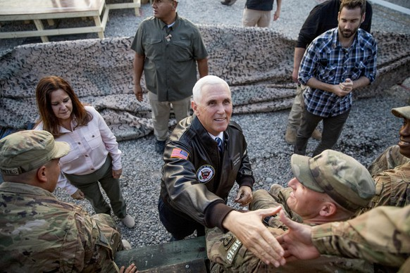 Vice President Mike Pence and his wife Karen Pence greets troops at Erbil International Airport in Erbil, Iraq, Saturday, Nov. 23, 2019. (AP Photo/Andrew Harnik) Mike Pence,Karen Pence