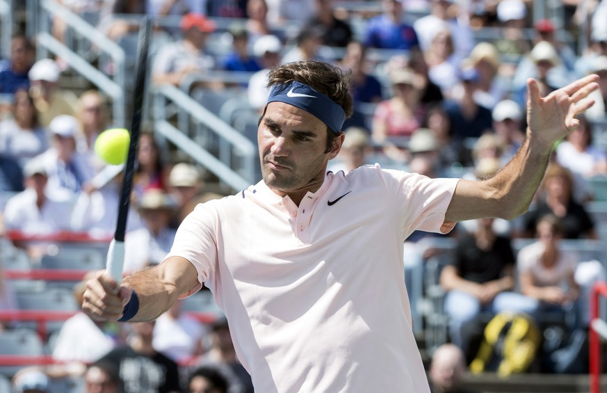 Roger Federer of Switzerland returns to Peter Polansky of Canada  at the Rogers Cup tennis tournament, Wednesday, Aug. 9, 2017 in Montreal. (Paul Chiasson/The Canadian Press via AP)