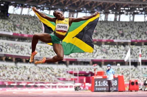 Yabba dabba doo: Megan Tapper feiert Bronze über 100 m Hürden im Stil von Fred Feuerstein.