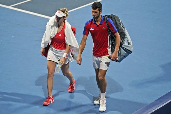 The Serbian mixed doubles team of Novak Djokovic, right, and Nina Stojanovic leave the court after being defeated by a team from the Russian Olympic Committee during the semifinals of the tennis competition at the 2020 Summer Olympics, Friday, July 30, 2021, in Tokyo, Japan. (AP Photo/Seth Wenig) Novak Djokovic,Nina Stojanovic