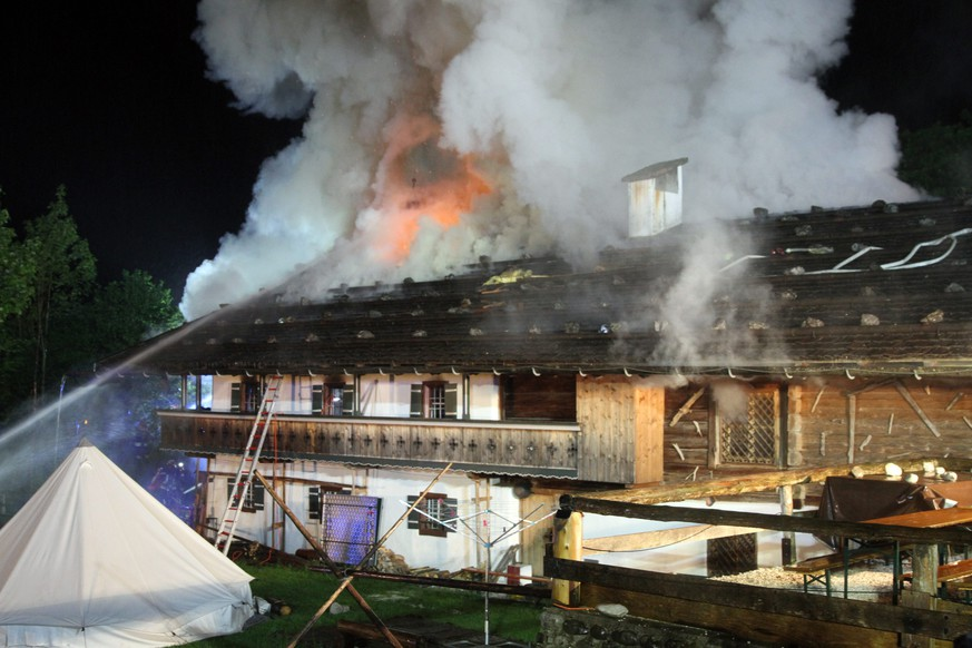 epa04763007 Firefighters try to extinguish a fire at an event hotel in Schneizlreuth, southern Germany, 23 May 2015. At least seven people were injured in the fire, according to police.  EPA/FERDINAND FARTHOFER