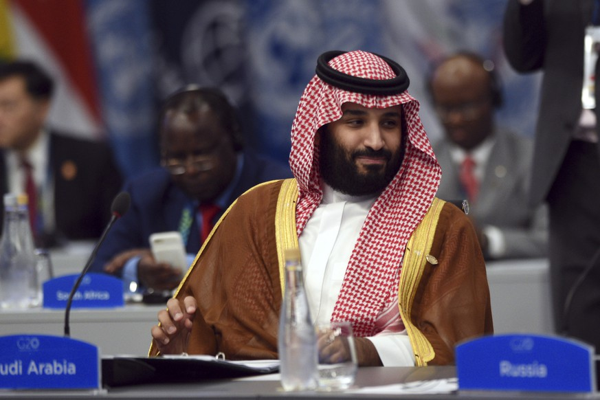 In this photo released by the press office of the G20 Summit Saudi Arabia's Crown Prince Mohammed bin Salman attends a plenary session on the second day of the G20 Leader's Summit in Buenos Aires, Argentina, Saturday, Dec. 1, 2018. (G20 Press Office via AP)