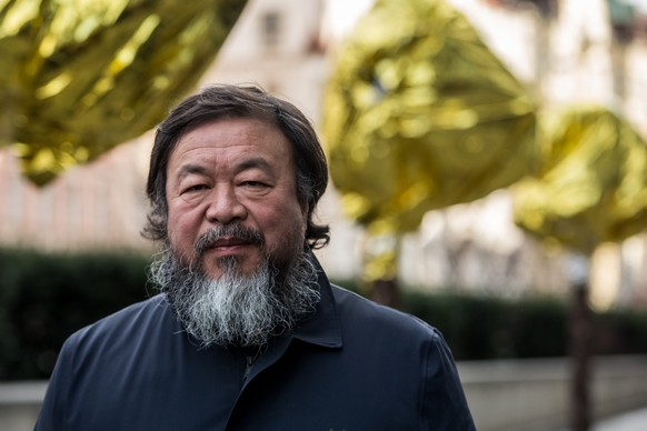 PRAGUE, CZECH REPUBLIC - FEBRUARY 05:  Chinese artist Ai Weiwei attends a gathering with media in front of the Trade Fair Palace run by the National Gallery on February 5, 2016 in Prague, Czech Republic. Ai Weiwei spoke to the media ahead of his 'Circle of Animals / Zodiac Heads' sculpture exhibition in front of the palace which runs from February 6 to August 31, 2016. Ai Weiwei wrapped his bronze heads with thermal blankets to protest against migrants situation in Europe. It is the first time that the artist exhibits his work in the Czech Republic.  (Photo by Matej Divizna/Getty Images)