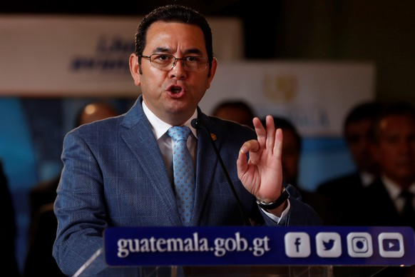 epa07818102 Guatemalan President Jimmy Morales speaks during a press conference at the National Palace of Culture in Guatemala City, Guatemala, 04 September 2019. Government of Guatemala declared the 'state of siege' in several municipalities of the country after the death of three soldiers in an ambush of drug trafficking, assuring that 'insurgent groups' have proliferated and that 'security and governance have been lost'.  EPA/Esteban Biba
