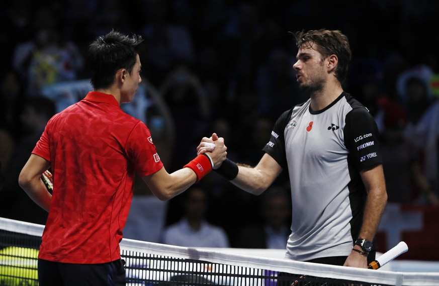 Britain Tennis - Barclays ATP World Tour Finals - O2 Arena, London - 14/11/16 Japan's Kei Nishikori shakes hands with Switzerland's Stanislas Wawrinka after winning their round robin match  Reuters / Stefan Wermuth Livepic EDITORIAL USE ONLY.