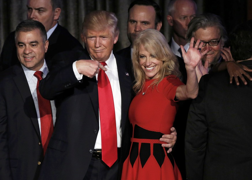 U.S. President-elect Donald Trump and his campaign manager Kellyanne Conway greet supporters during his election night rally in Manhattan, New York, U.S., November 9, 2016.   REUTERS/Mike Segar