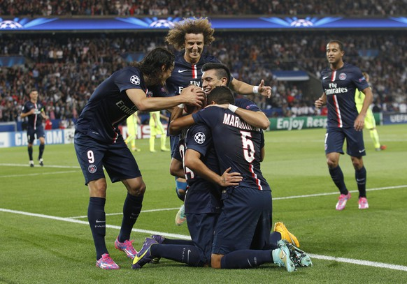 PSG players celebrate after Marco Verratti scored his side's second goal during the Champions League soccer match between PSG and Barcelona, at the Parc des Princes stadium, in Paris, Tuesday, Sept. 30, 2014. (AP Photo/Christophe Ena)