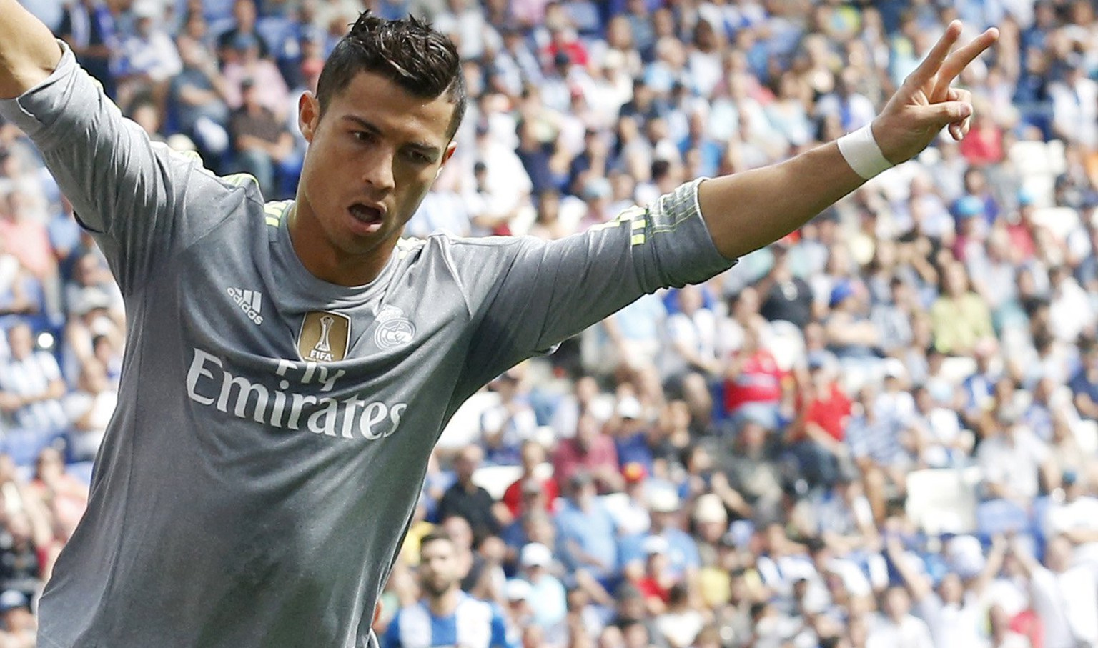 Real Madrid's Cristiano Ronaldo celebrates a goal against Espanyol during their Spanish first division soccer match in Cornella de Llobregat, near Barcelona, Spain, September 12, 2015. REUTERS/Albert Gea