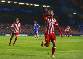 Atletico's Adrian Lopez celebrates after he scored a goal against Chelsea during their Champions League semi-final second leg soccer match at Stamford Bridge in London, April 30, 2014.      REUTERS/Eddie Keogh (BRITAIN  - Tags: SPORT SOCCER)